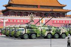 Insight: China ups the ante by firing missiles into troubled waters