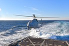 MQ-8C Fire Scout flies from US Navy destroyer