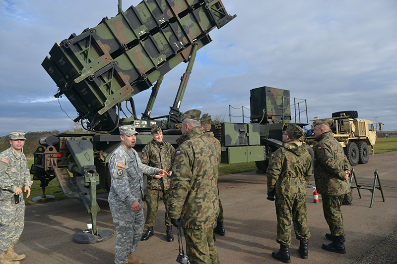 In a 2015 visit to 5th Battalion, 7th Air Defense Artillery Regiment at Smith Barracks, Baumholder, Germany, Polish soldiers were briefed about individual pieces of equipment. (US Army photo)