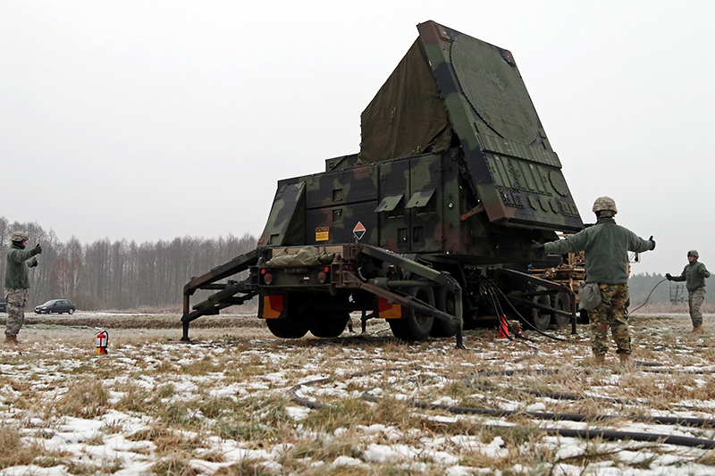 Soldiers signal the area is clear while emplacing the Patriot radar set during Panther Assurance, an interoperability deployment readiness exercise,  in 2016, at Skwierzyna, Poland. (US Army photo)